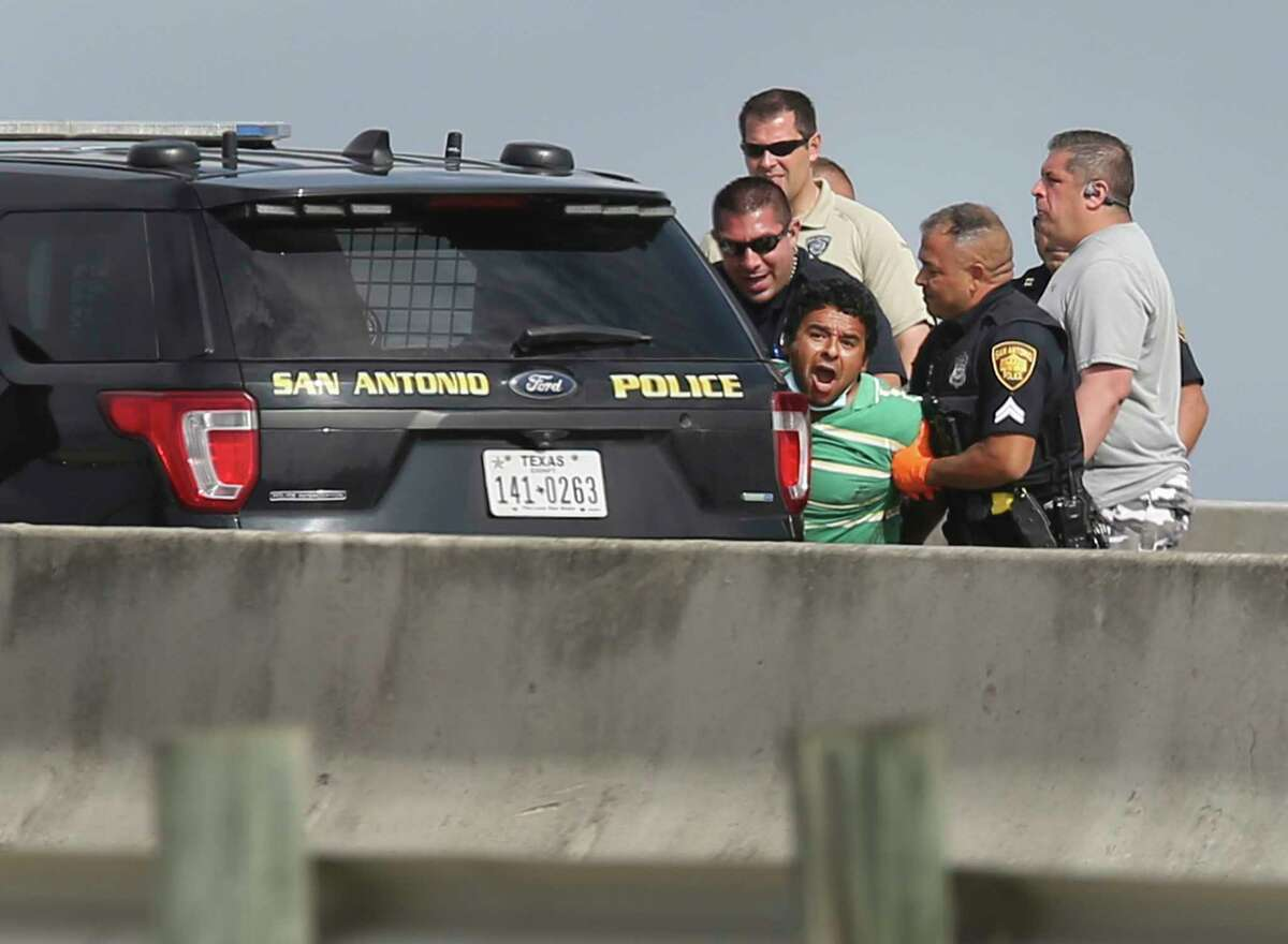 A man kept police at bay on an overpass of I-35 near Zarazamora threatening to take his life on Tuesday, Mar. 16, 2021. The incident forced both the northbound and southbound lanes to be shut down in the area and traffic diverted for about four hours as police negotiated with him. The situation ended after police were able to lure the man away from the ledge and subdue him. The man still appeared agitated and yelling until they placed him into an awaiting ambulance.