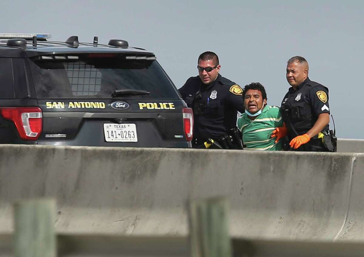A man kept police at bay for nearly four hours on an overpass of I-35 near Zarazamora threatening to take his life on Tuesday, Mar. 16, 2021. The incident forced both the northbound and southbound lanes to be shut down in the area and traffic diverted for about four hours as police negotiated with him. The situation ended after police were able to lure the man away from the ledge and subdue him. The man still appeared agitated and yelling until they placed him into an awaiting ambulance.