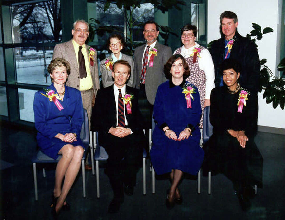 JoAnn Nabe, who is retiring from the Edwardsville Public Library Board of Trustees after 40 years, was a board member in 1991 when the library underwent its last major addition. Front row left to right: Carole Wohlford, Charles Nelson, Susan Fremming and Carlotta Cowan. Back row left to right: Bob Wolf, Faye Cassens, Richard Madison, JoAnn Nabe and Stephen Thomson.