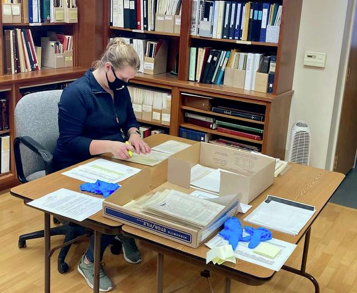 Jennifer VanBibber from the Madison County Historical Society examines Civil War documents related to the Alton Confederate Prison. The historical society recently donated the materials to the Illinois State Archives.