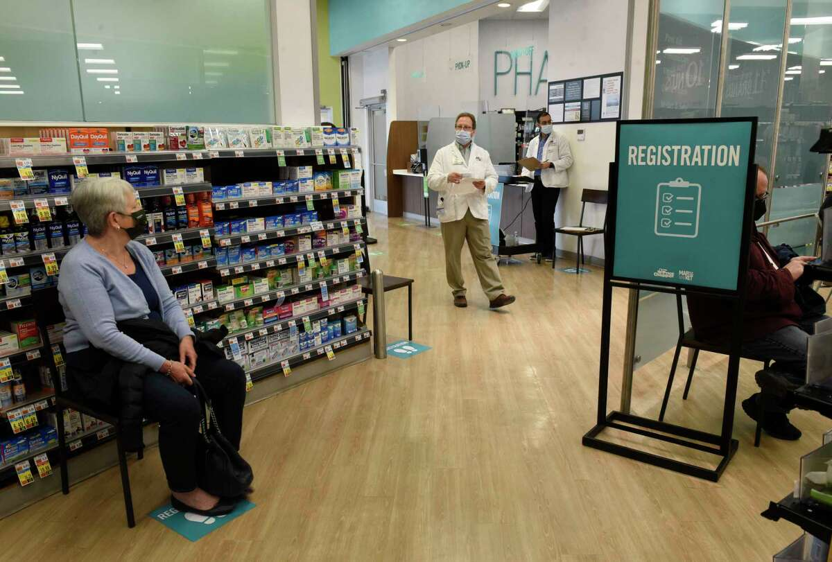 """Pharmacy manager Michael Sherwood, second from left, calls on the next person to be vaccinated for COVID-19 at a """"super clinic"""" held at Market 32 by Price Chopper pharmacy on Wednesday, March 17, 2021 in Clifton Park, N.Y. (Lori Van Buren/Times Union)"""