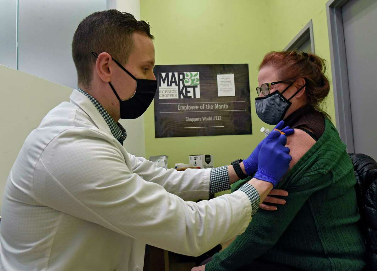 """Pharmacist Richard Pachucki administers the COVID-19 vaccine to Cheryle Harbour of Menands at a """"super clinic"""" held at Market 32 by Price Chopper pharmacy on Wednesday, March 17, 2021 in Clifton Park, N.Y. People ages 30 and up can begin to get the vaccine on March 30, 2021. (Lori Van Buren/Times Union)"""