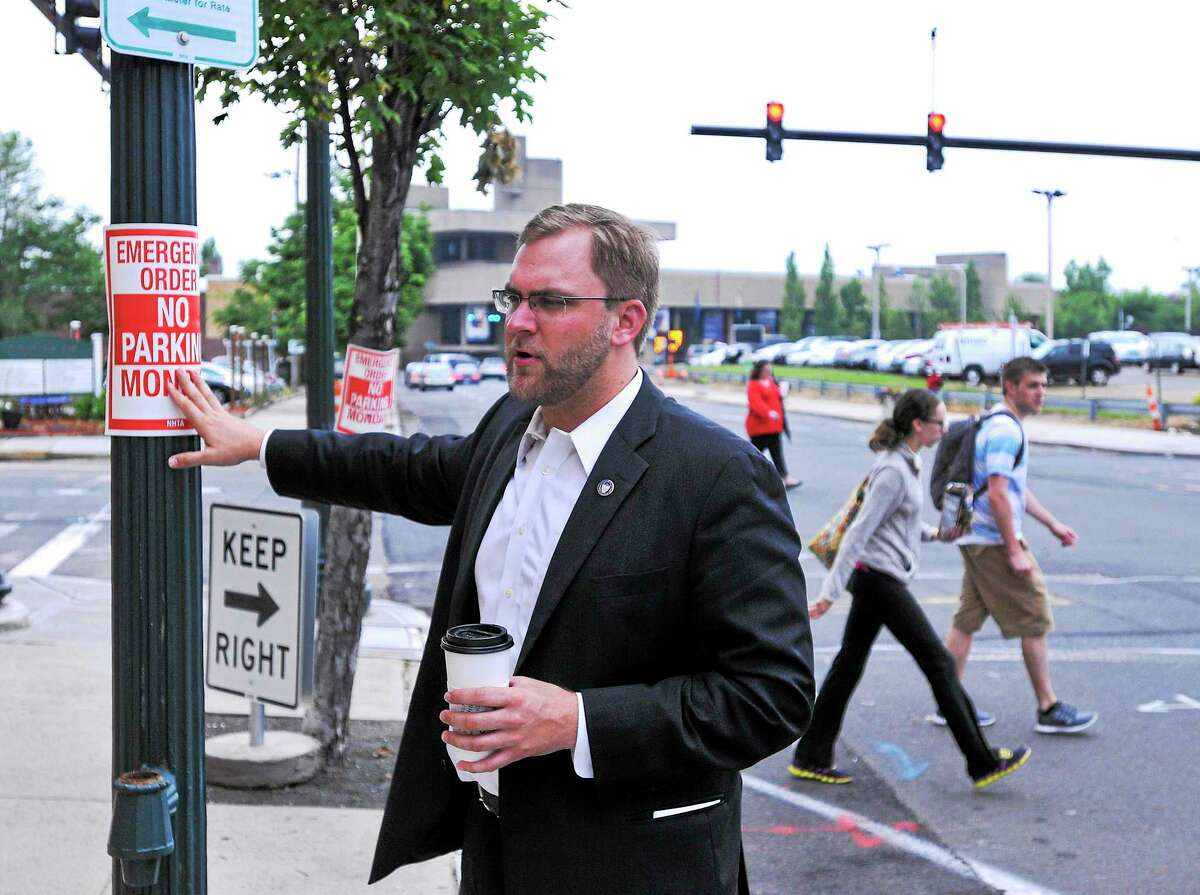 Douglas Hausladen explaining a new traffic pattern along George Street in New Haven.