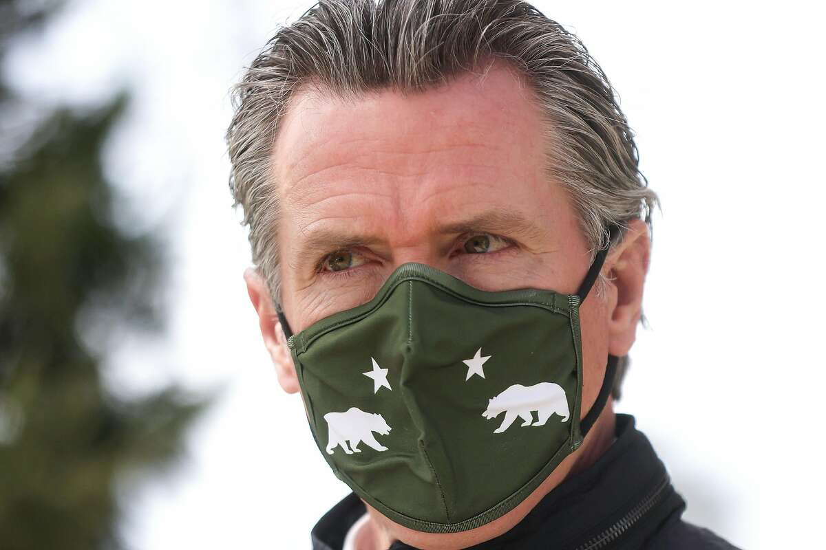 California Gov. Gavin Newsom visits a mobile COVID-19 vaccination center on March 10, 2021, in South Gate, Calif.