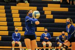 Jenna Bromley makes a bump set during Onekama's district championship win over Brethren last fall. (News Advocate file photo)