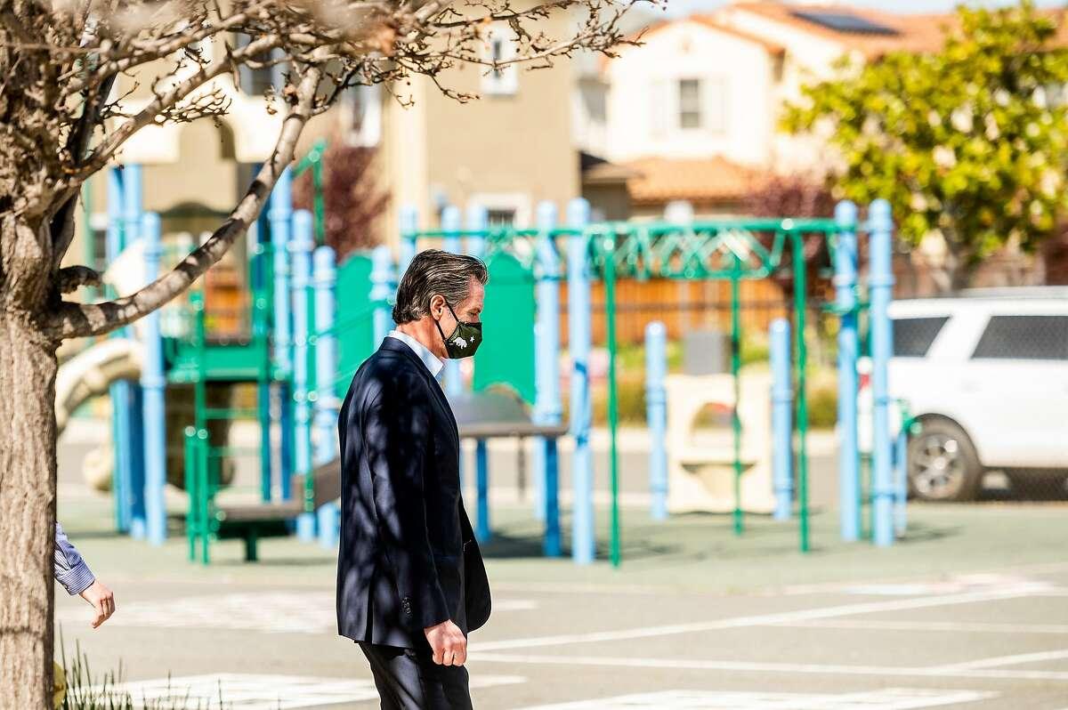 Gov. Gavin Newsom leaves Ruby Bridges Elementary School in Alameda following an appearance on Tuesday.