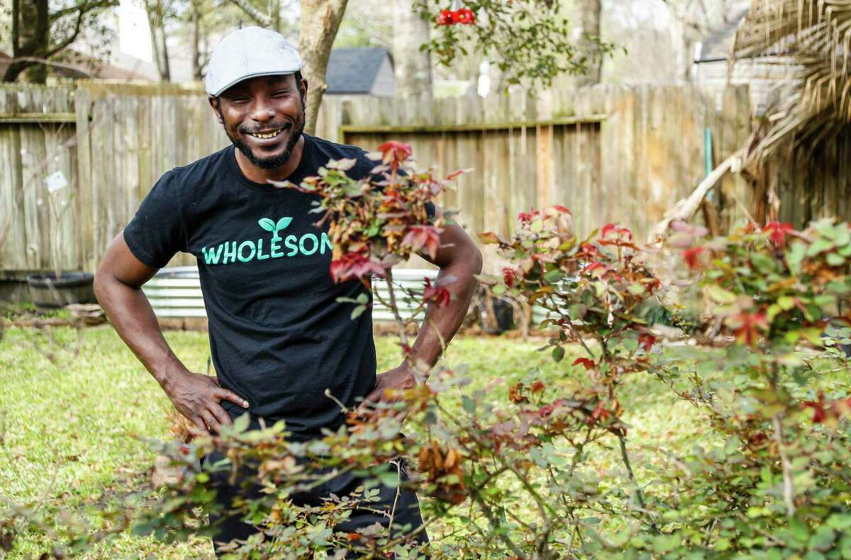 Marcus Bridgewater, also known as Garden Marcus, works with his rose bushes, which are budding out after the winter blast, in his backyard in Spring. Marcus' garden videos filled with positivity and good vibes have gained him a TikTok following.