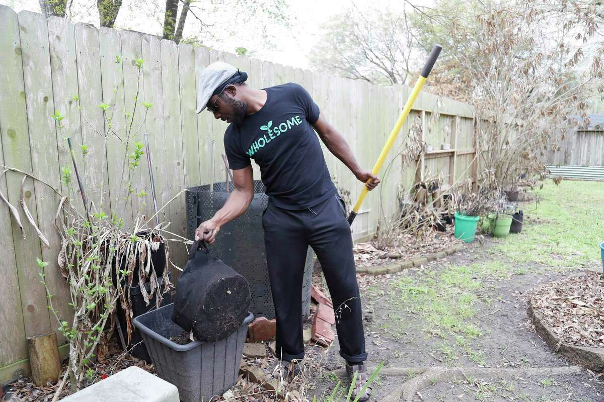 Marcus Bridgewater, also known as Garden Marcus, works in his backyard in Spring cleaning up after the freeze.