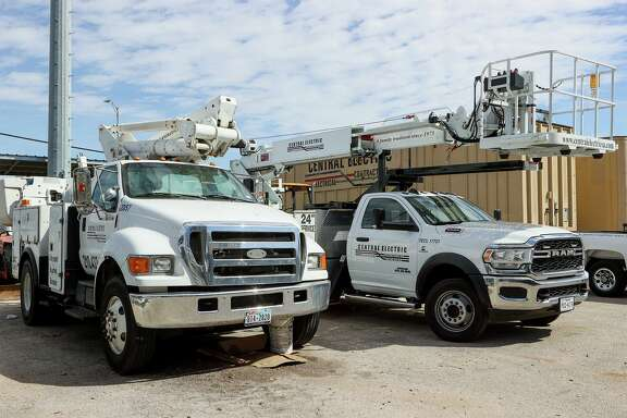 Work trucks in the parking lot of Central Electric, which was founded in 1975.