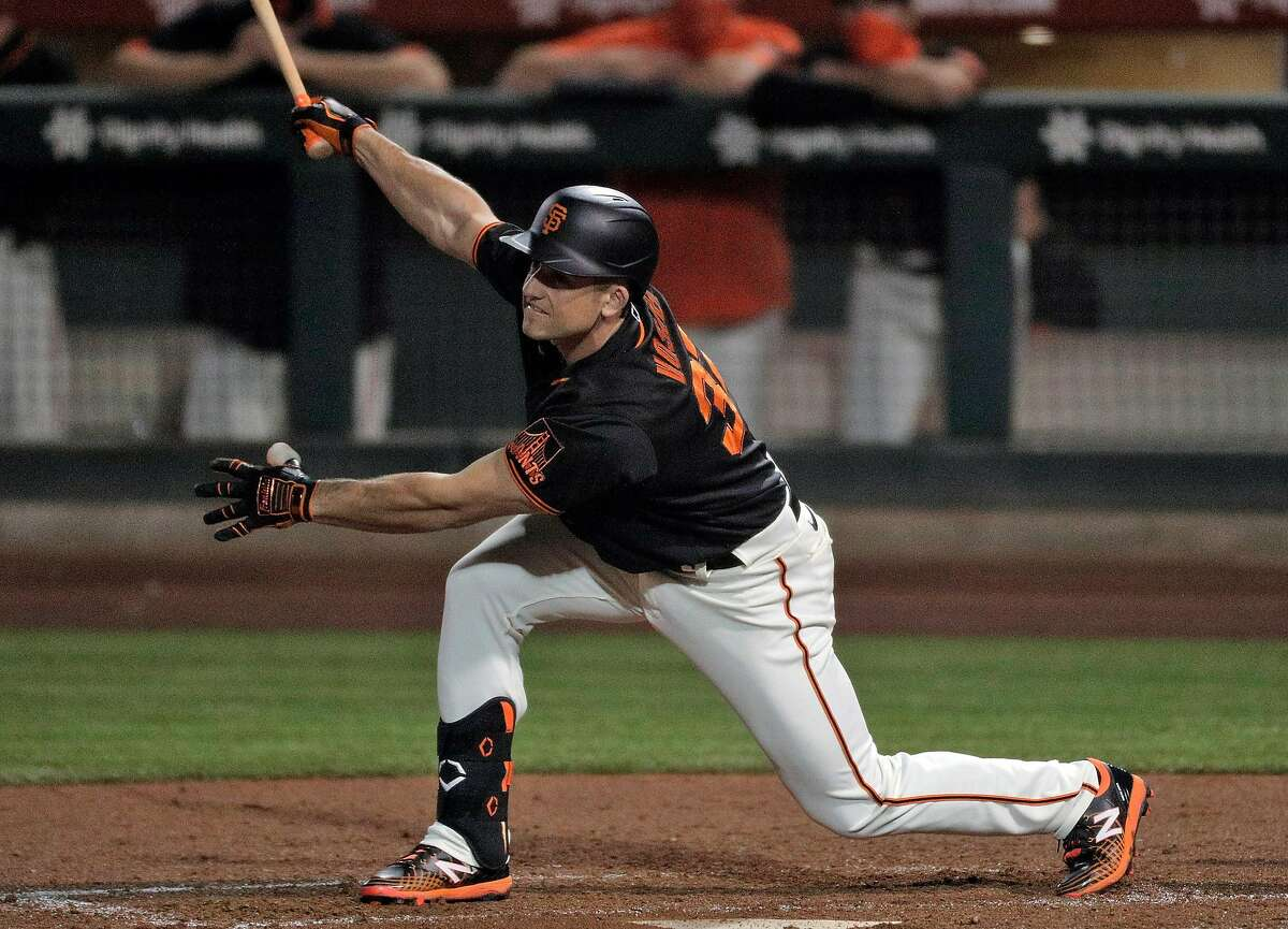 Jason Vosler (32) of the San Francisco Giants bats against the Los Angeles Dodgers at Scottsdale stadium in Scottsdale, Ariz., on Tuesday, March 2, 2021.