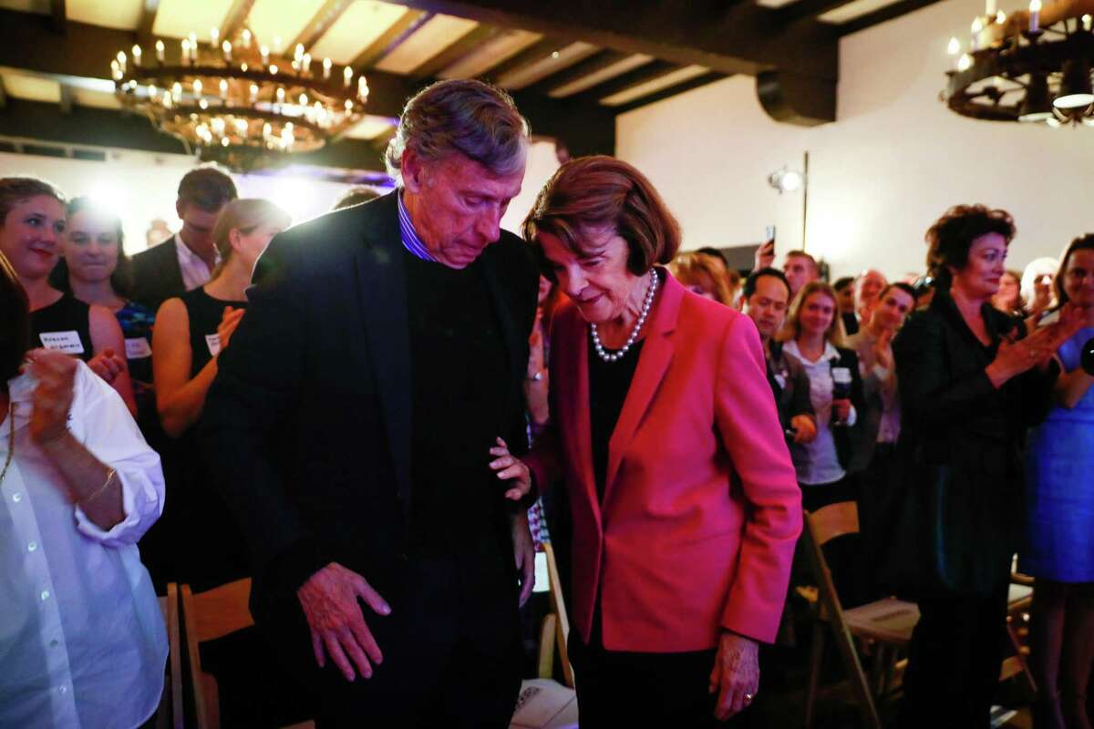 Sen. Dianne Feinstein and husband Richard Blum (left) at the Presidio Officers Club after her re-election.