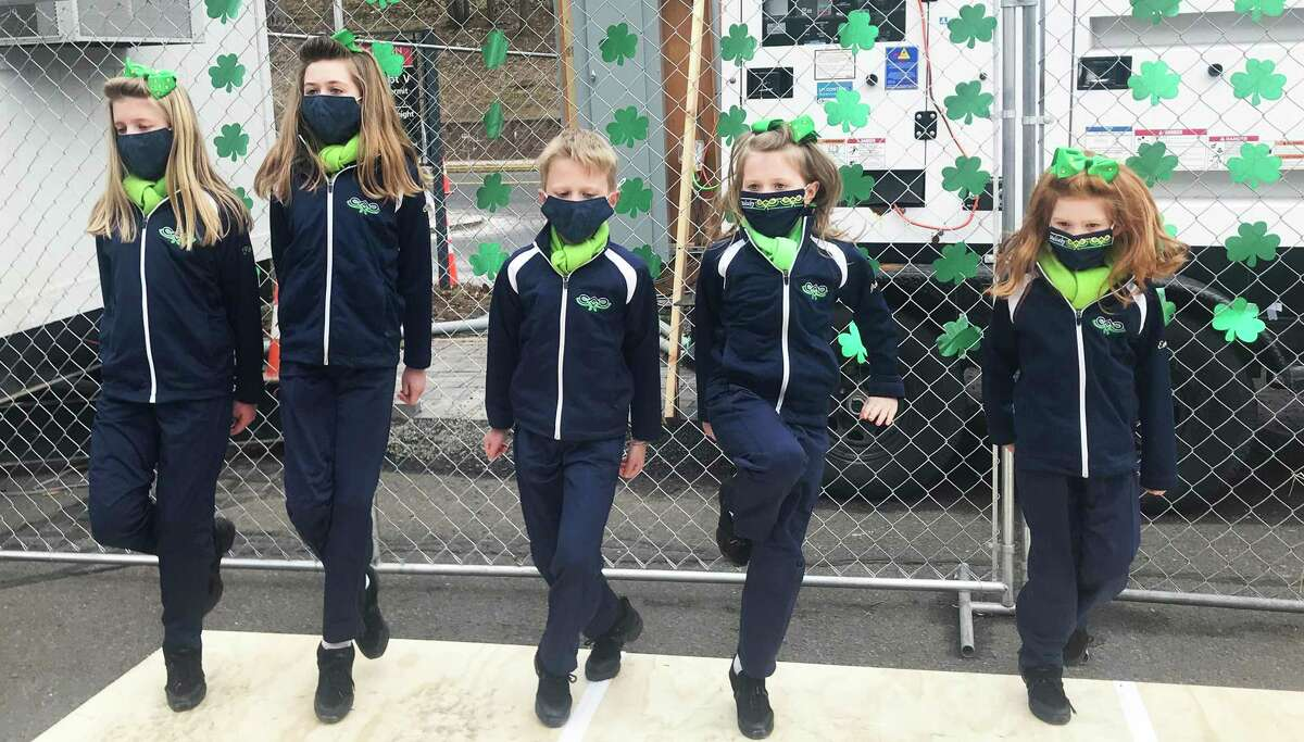 Irish step dancers from Griffith Academy of Wethersfield and Mulcahy Academy of Glastonbury entertained spectators and motorists in line at the Community Health Center's mass vaccination clinic on Vine Street in Middletown Wednesday to celebrate St. Patrick's Day.