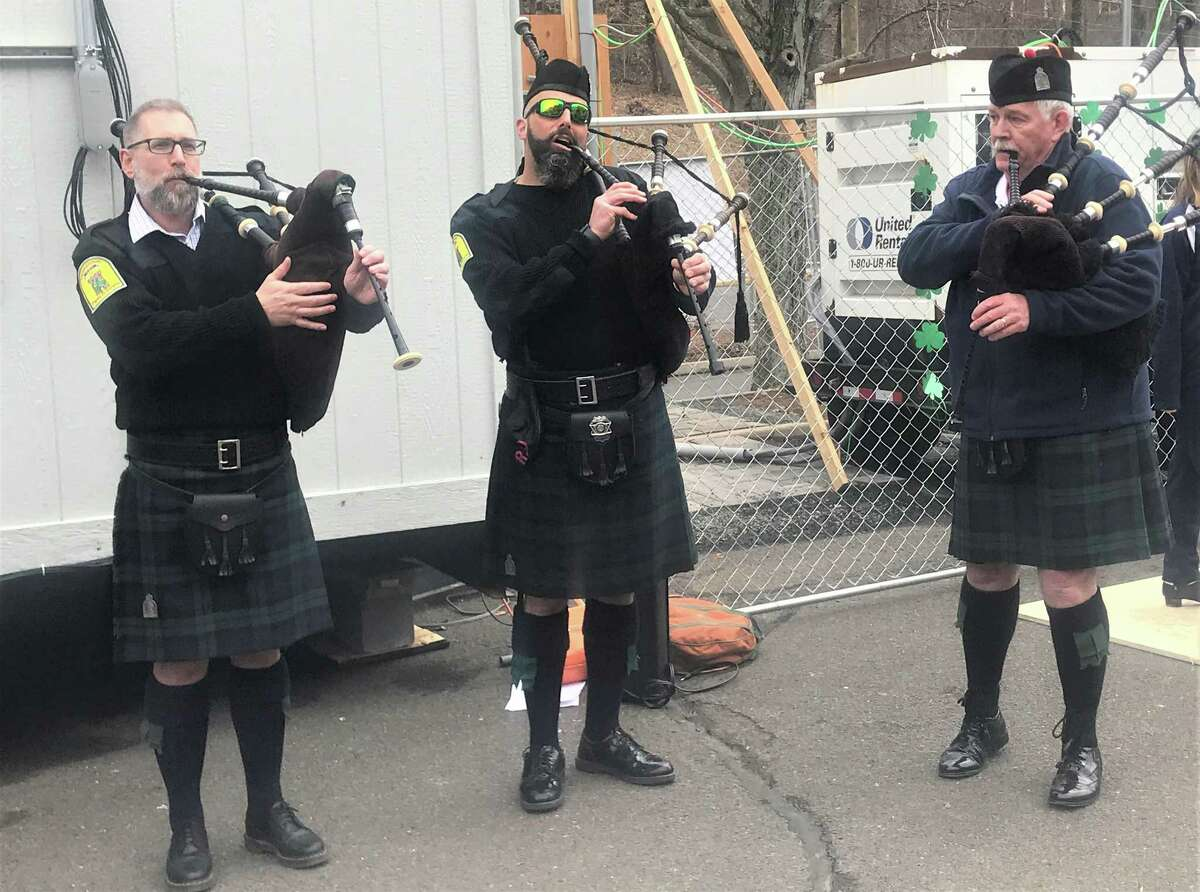 Members of the Middletown PBA Pipes & Drums band entertained the crowd Wednesday at the Community Health Center COVID-19 vaccination clinic on Vine Street for St. Patrick's Day.