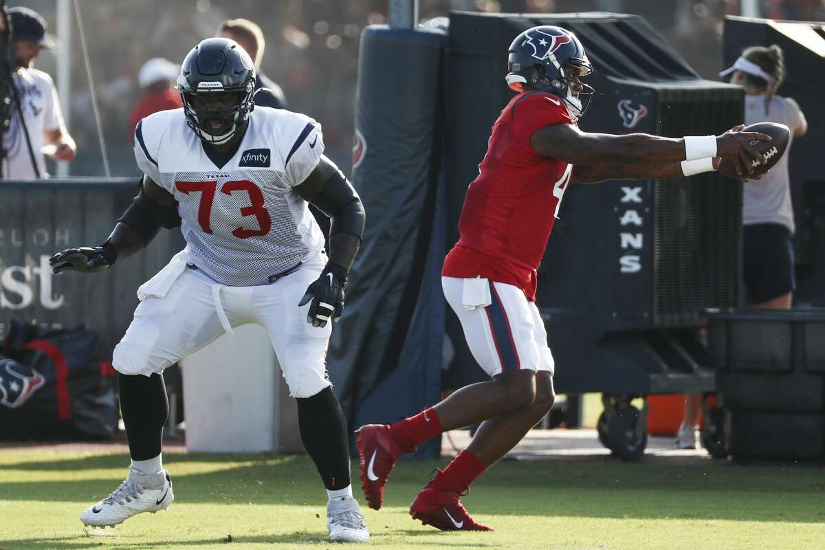 Houston Texans quarterback Deshaun Watson (4) works on handoff techniques after taking a snap from offensive lineman Zach Fulton (73) during a joint training camp practice with the Detroit Lions at the Houston Methodist Training Center on Thursday, Aug. 15, 2019, in Houston.