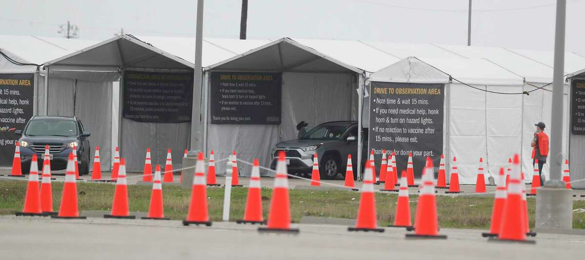 Vehicles line up inside of tents as Memorial Hermann hosted a vaccine hub at Smart Financial CenterMonday, March 15, 2021, in Sugar Land. This is the first day of 50+ vaccinations in Texas.
