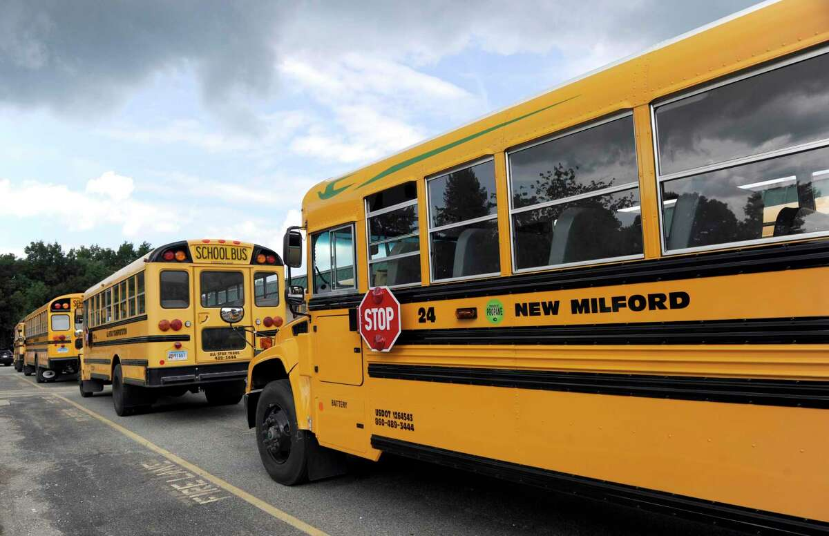 Propane-fueled buses line up at the end of the school day at Schaghticoke Middle School in New Milford Thursday, Sept. 1, 2016.