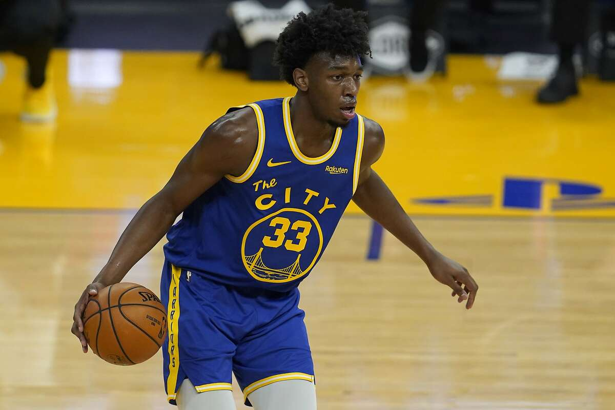 Golden State Warriors center James Wiseman (33) against the Utah Jazz during an NBA basketball game in San Francisco, Sunday, March 14, 2021. (AP Photo/Jeff Chiu)