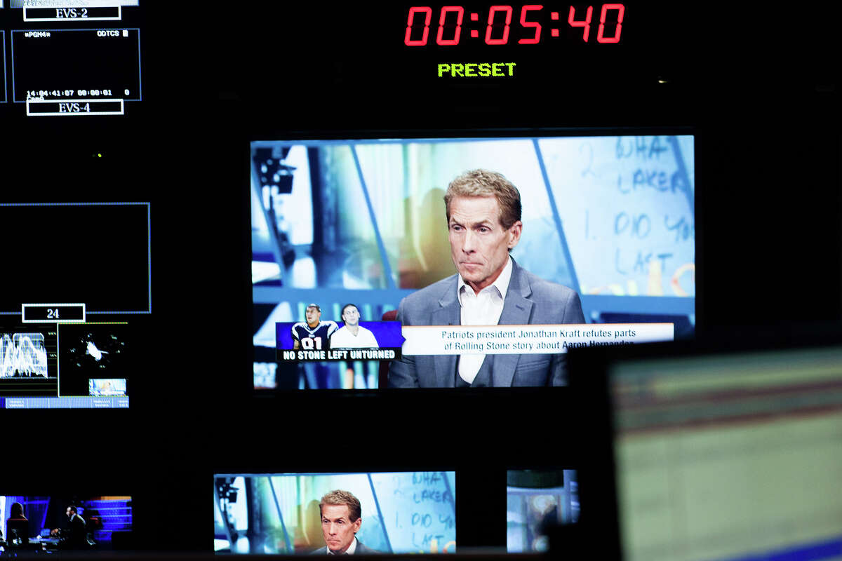 """Television personality Skip Bayless can be seen on television screens in the control room during the live filming of """"First Take"""" on Aug. 30, 2013, at ESPN Headquarters."""