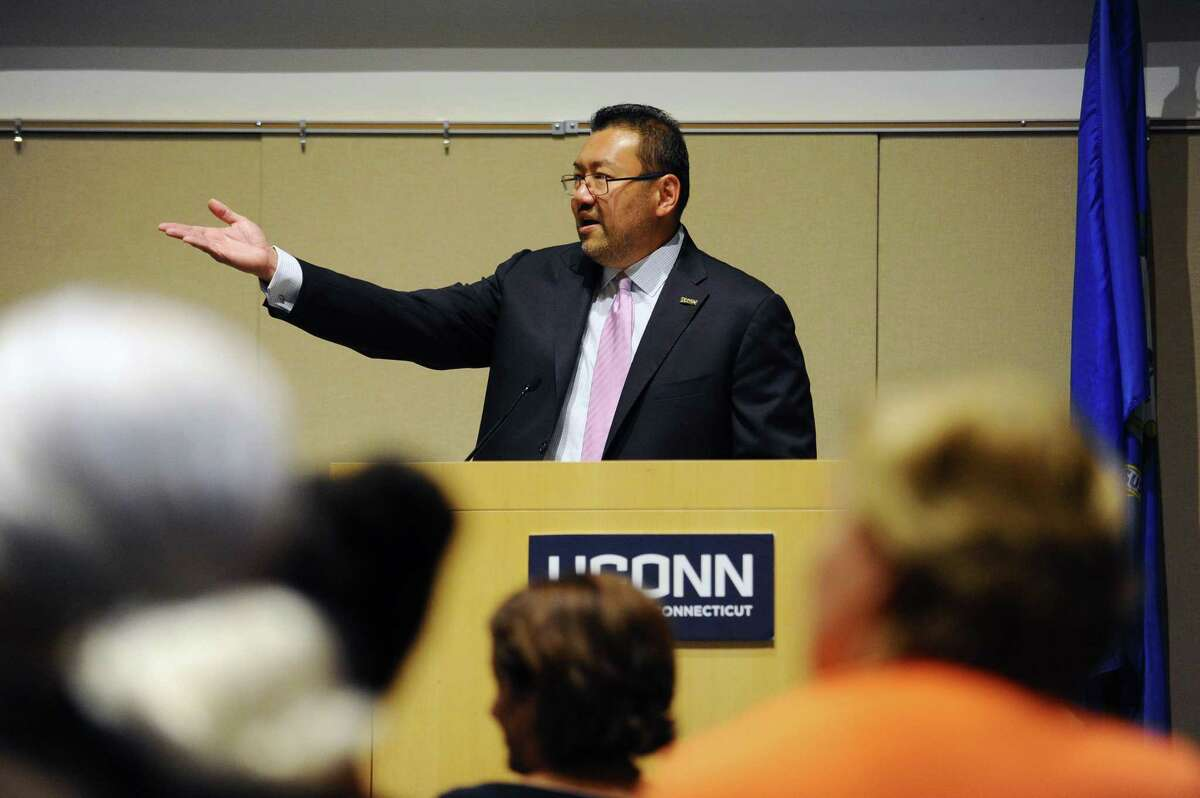 """UConn Stamford director Terrence Cheng speaks during the annual convocation inside the GenRe Auditorium in Stamford, Conn. on Wednesday, Sept. 13, 2017. Cheng will lead a panel on Thursday entitled """"Anti-Asian Violence and the Fight Against Invisibility."""""""
