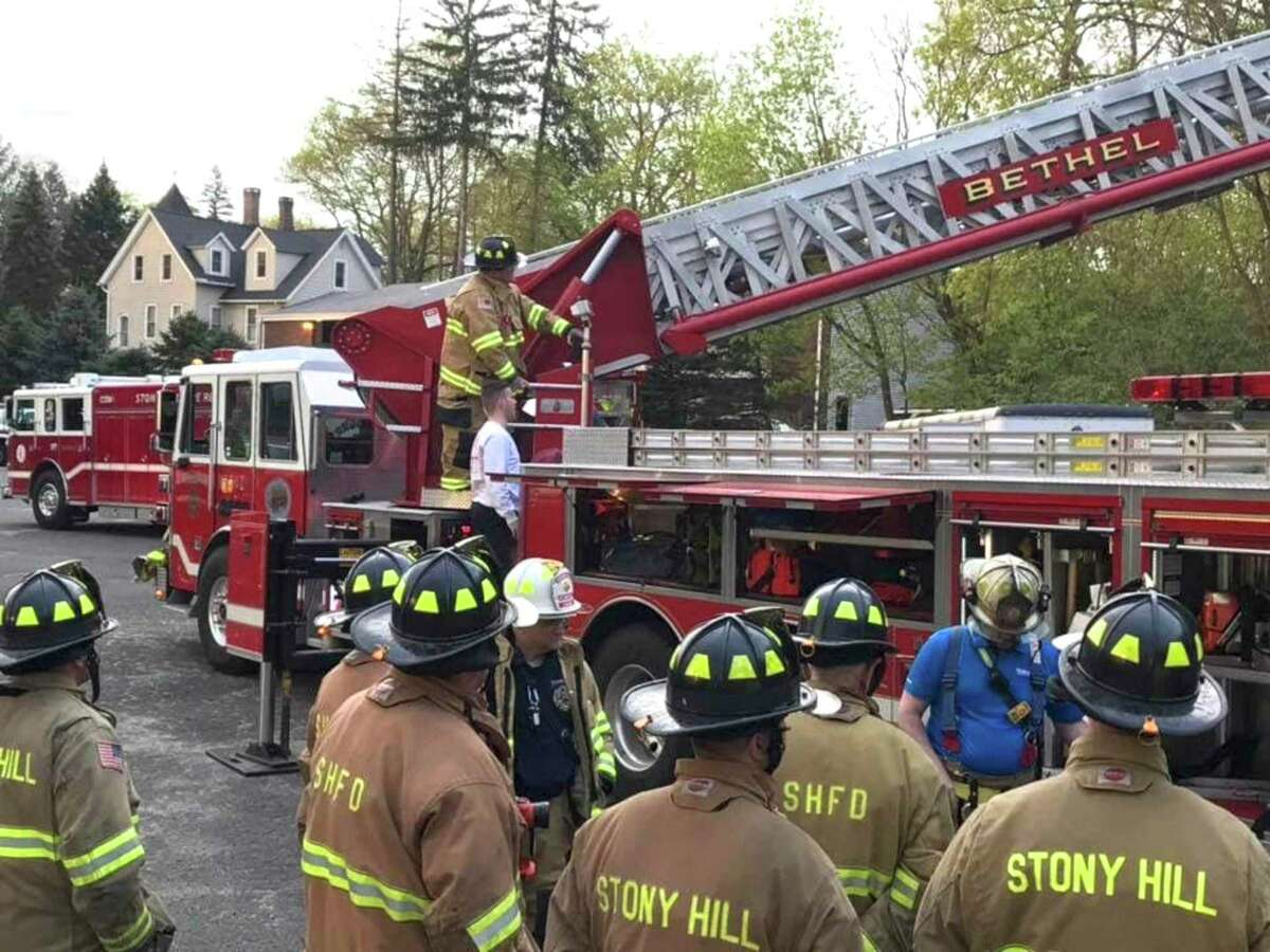 Bethel Volunteer Fire Department and Stony Hill Volunteer Fire Company firefighters train on an aerial ladder truck in 2020.