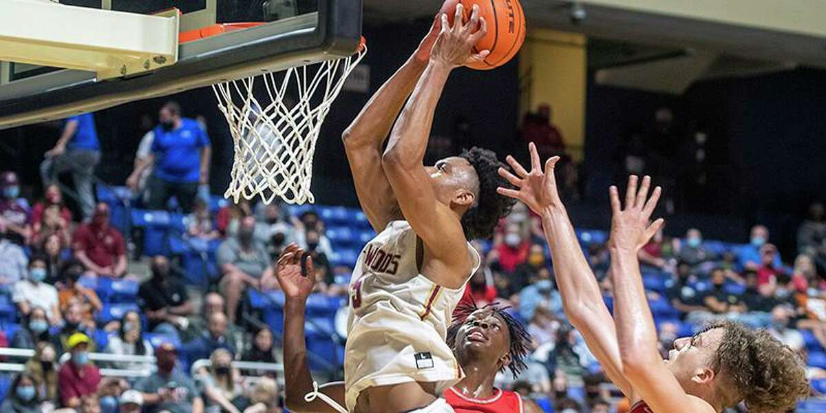 Cypress Woods High School senior Damian Watson, with ball, was named the District 16-6A boys' basketball Most Valuable Player.