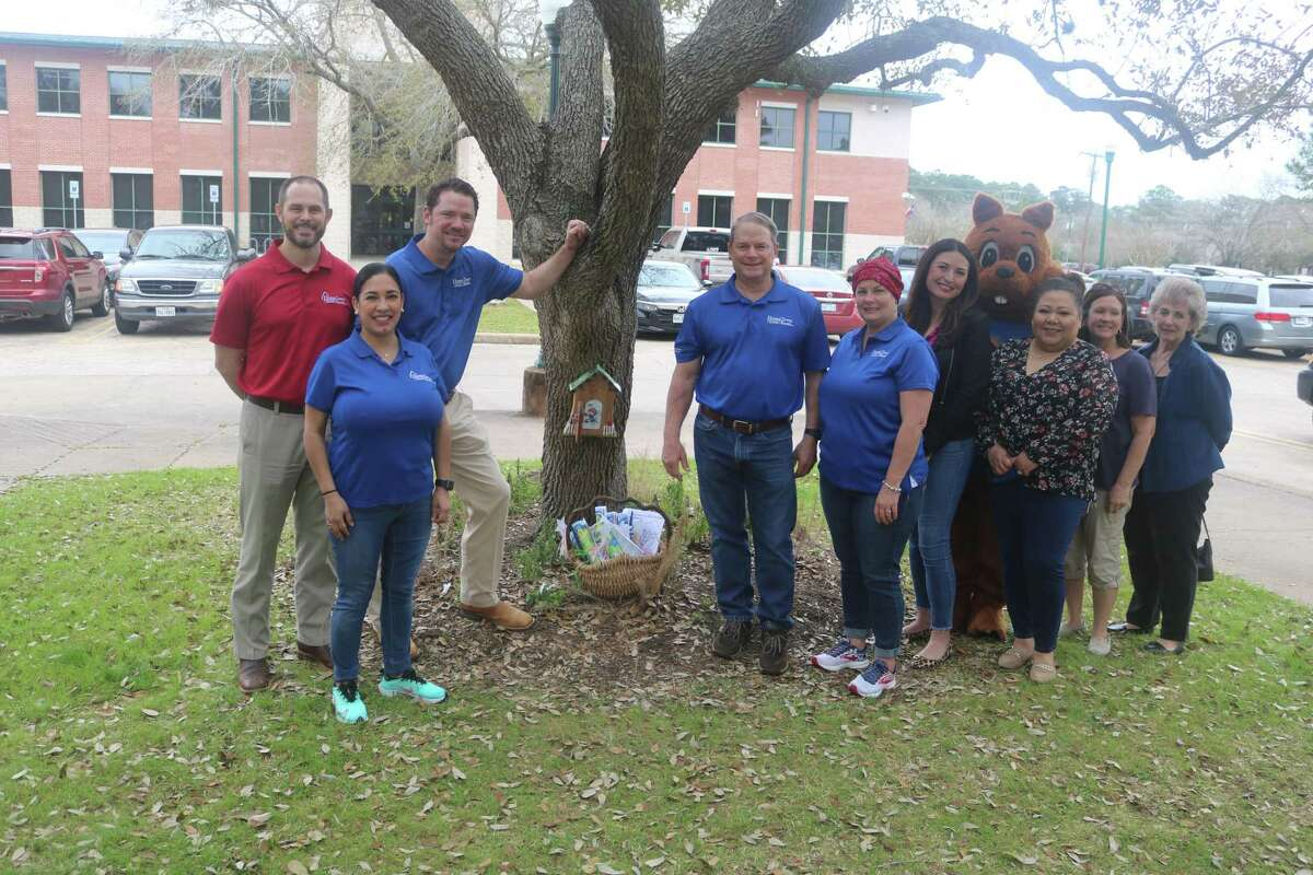 Hometown Bank representatives are joined by Keep Friendswood Beautiful representatives in celebrating the Friendswood Fairy Trail's newest fairy door, home to Didi the Dollar Fairy.