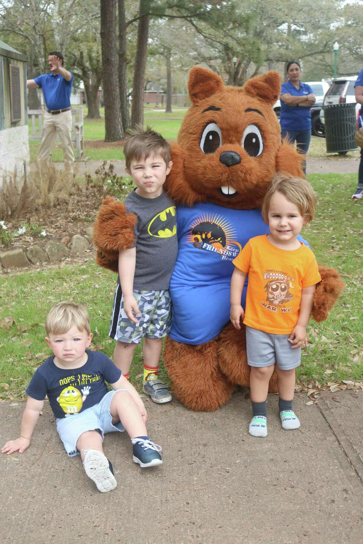 Following the ceremony honoring the new Fairy Trail Door, Figgy, the Friendswood mascot, was visited by Carter Wilhoite-Moore, left, Everett Requardt and Seth Austin.