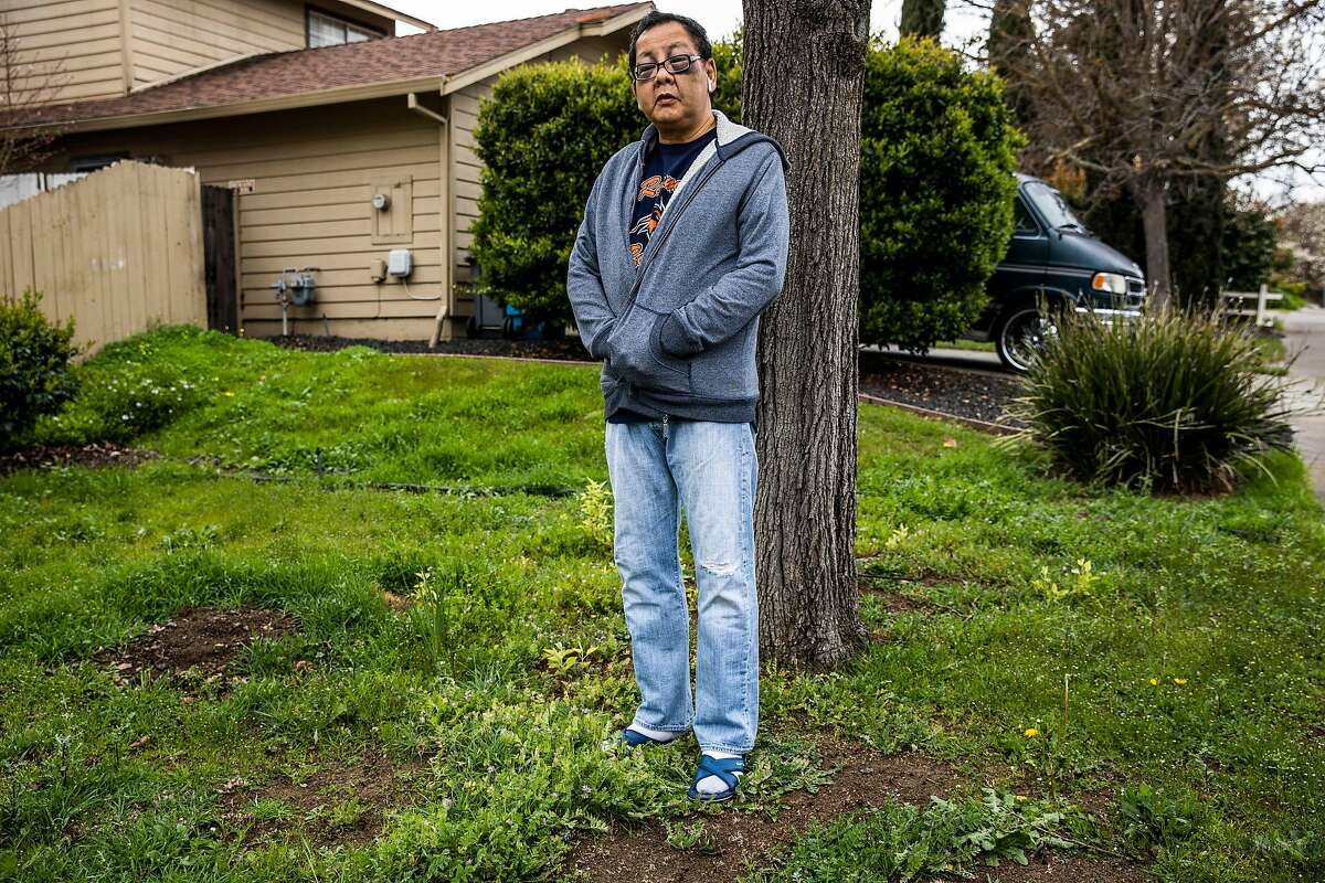Danny Yu Chang, 59, who was beaten in an unprovoked attack on Market Street in San Francisco on Monday, stands outside his home in Vallejo. Yu Chang and his wife are planning to move out of California in search of a safer place to live as violent crimes against Asian Americans continue to rise throughout the country.