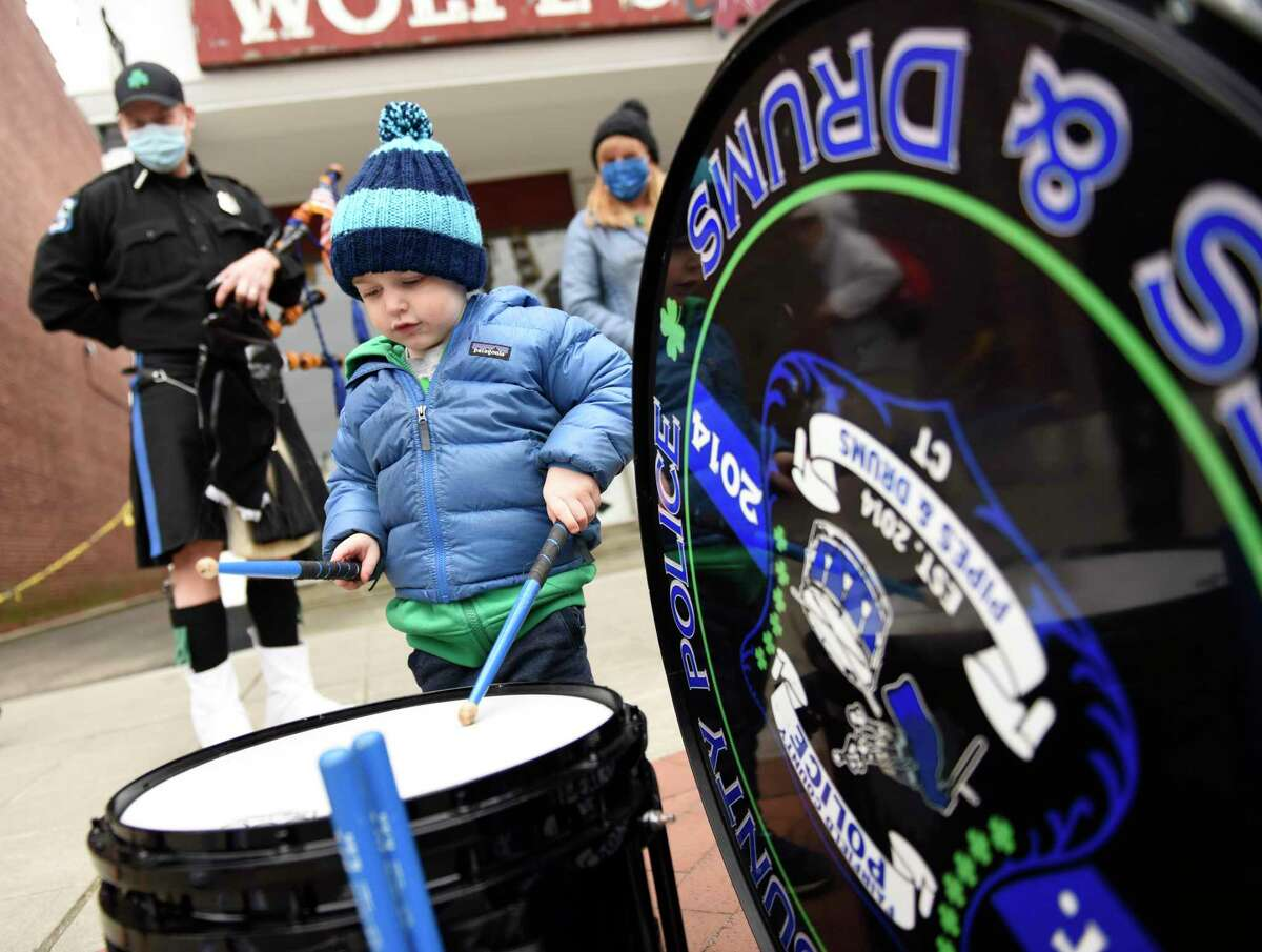 Stamford's William Fitzsimmons, 2, plays the drums before the Fairfield County Police Pipes and Drums concert in Stamford.