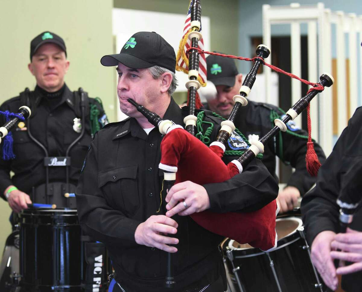 Fairfield County Police Pipes and Drums perform Wednesday in Stamford, in celebration of St. Patrick's Day. The group played a free concert for passersby in the window of a vacant store on Bedford Street. The musicians plan to hold more pop-up window performances throughout the year. More photos on A3