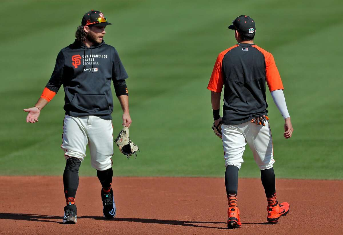 Brandon Crawford can often be seen chatting with Mauricio Dubón, who often is in Crawford's group during practice.