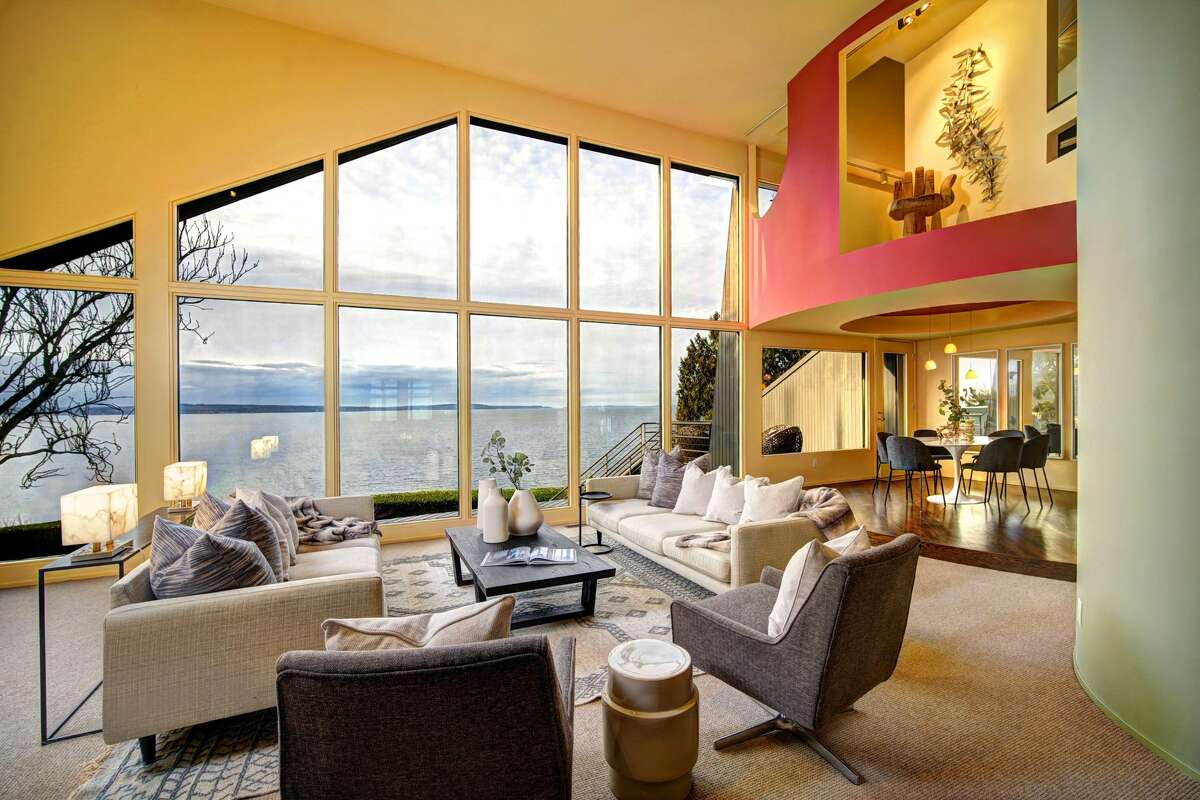 Inside the lofty living room space, with the Sound as a backdrop to the open floor plan.