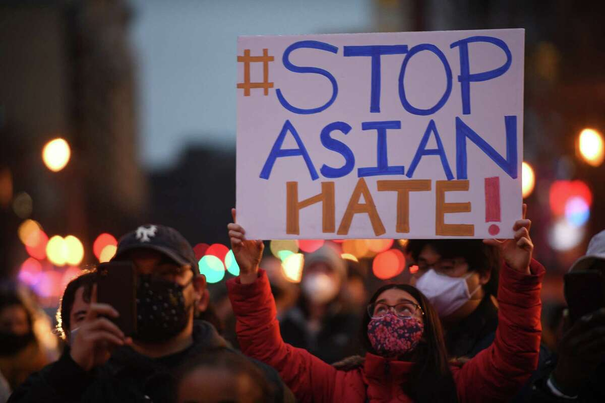 A vigil and march to remember and honor the eight lives lost Tuesday in Atlanta, Ga., takes place in the Chinatown area of the District of Columbia on Wednesday, March 17, 2021.