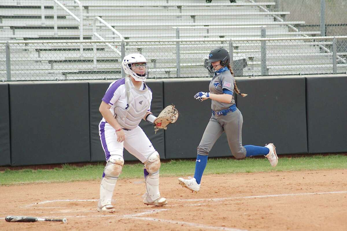 Friendswood's Baileigh Burtis, shown scoring a run earlier this season against Humble, drove in a sixth-inning run Wednesday night in a 7-0 Lady Mustang victory over Manvel.