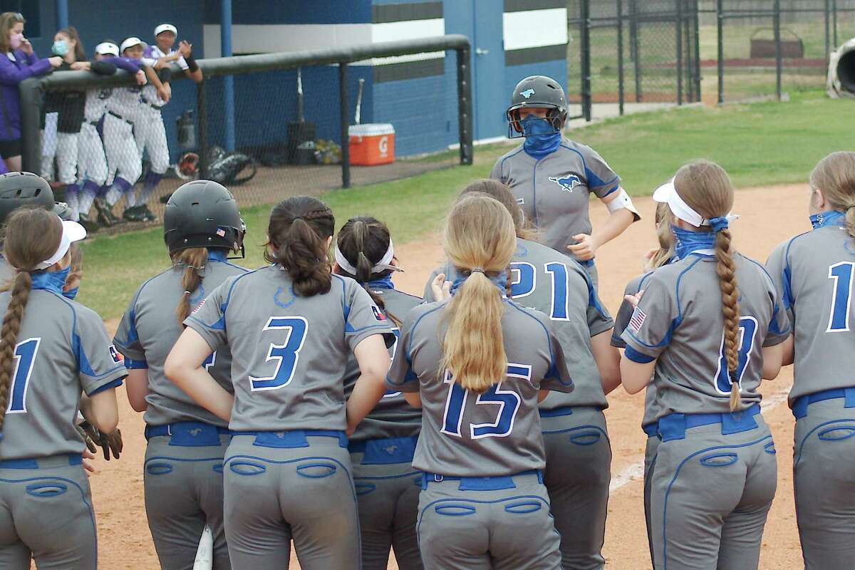 Friendswood's Patricia Yarotsky, greeted by teammates after hitting a home run against Humble earlier this season, belted a two-run double Wednesday night to help power the Lady Mustangs to a 7-0 win over Manvel.