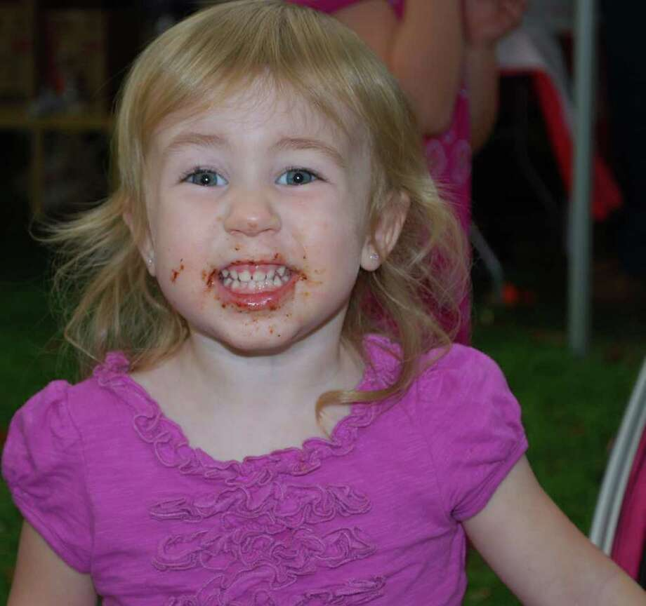 Kaley Herring, 2, of New Milford sports a chocolate smile after enjoying a chocolate chip cookie from Kelly's Sweet Spot at the Greater New Milford Chamber of Commerce's A Taste of New Milford held on the Village Green Sept. 8, 2010. Photo: Deborah Rose / The News-Times