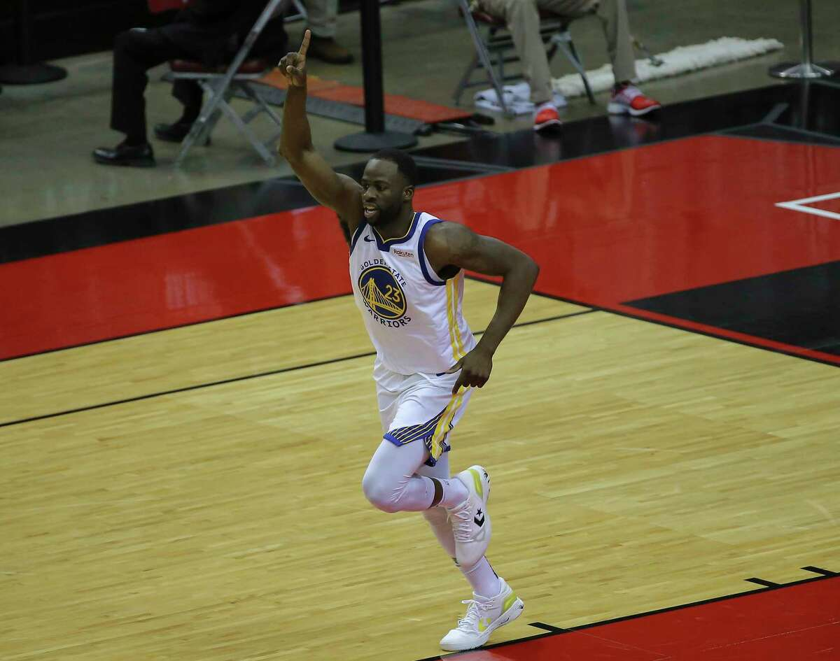 Golden State Warriors forward Draymond Green (23) celebrates scoring a basket during the third quarter of the NBA game against the Houston Rockets Wednesday, March 17, 2021, at Toyota Center in Houston.