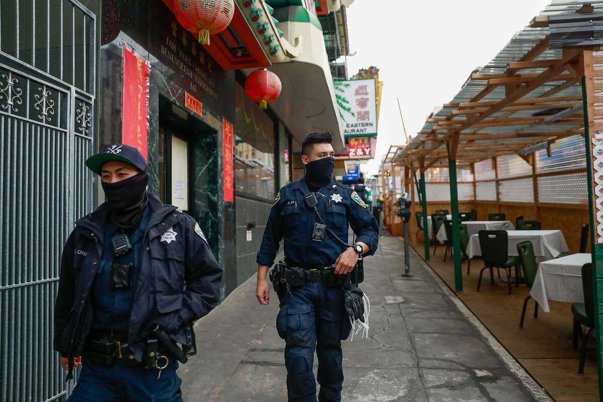 Police officers Loren Chiu (left) and William Ma patrol in Chinatown on Wednesday, March 17, 2021 in San Francisco, California.San Francisco police officers are adding extra patrols in Asian neighborhoods in the wake of shootings in Atlanta that left several Asian women dead.