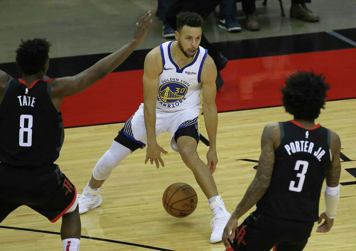 Warriors guard Stephen Curry, center, couldn't be blamed if he found Wednesday's night's Rockets unrecognizable.