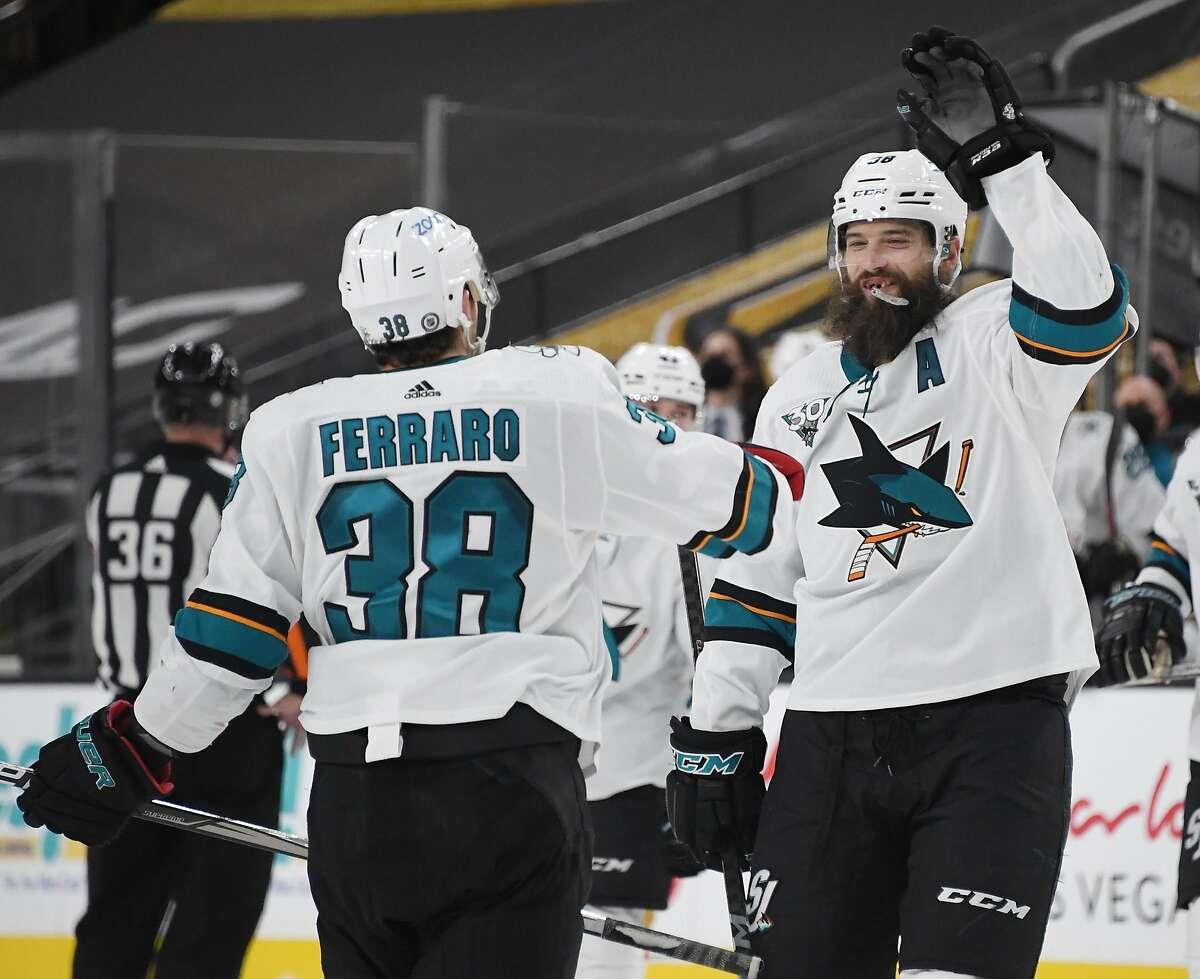 Sharks defensemen Brent Burns and Mario Ferraro celebrate after Ferraro scored a second-period goal against Vegas.