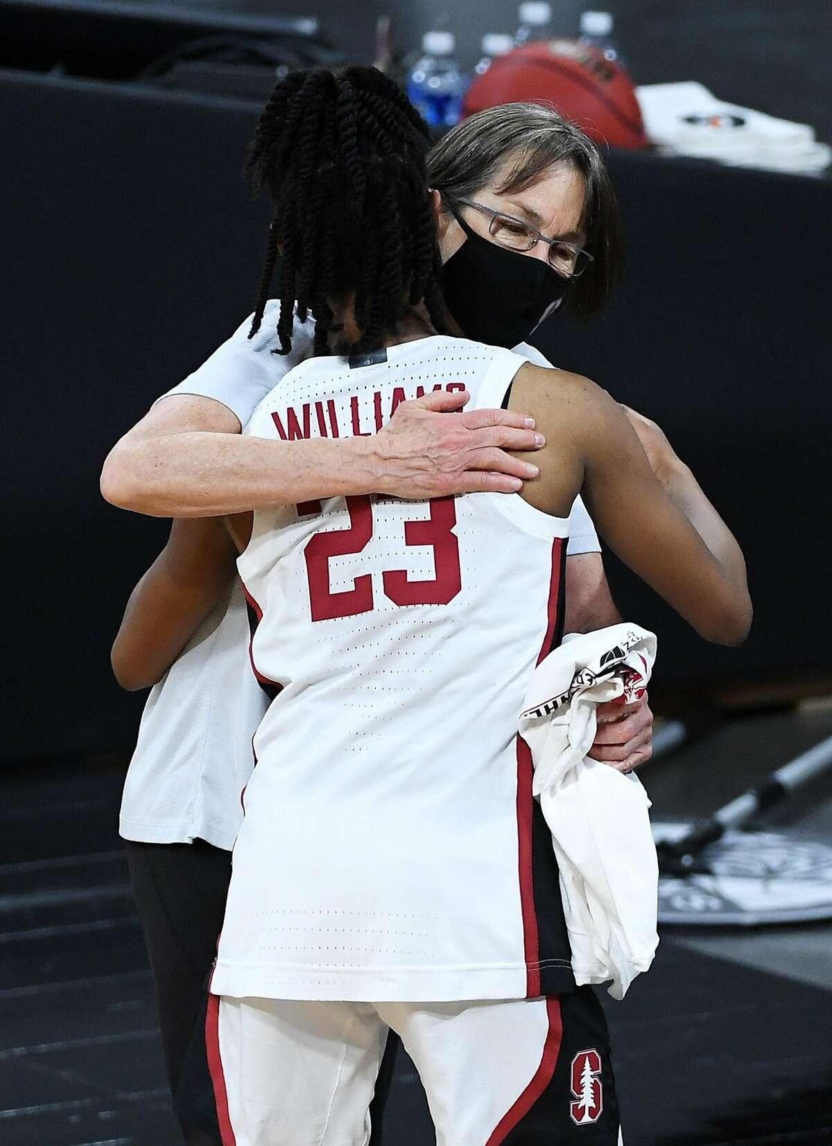 Coach Tara VanDerveer hugs Kiana Williams, the team's leading scorer (14.3 a game).