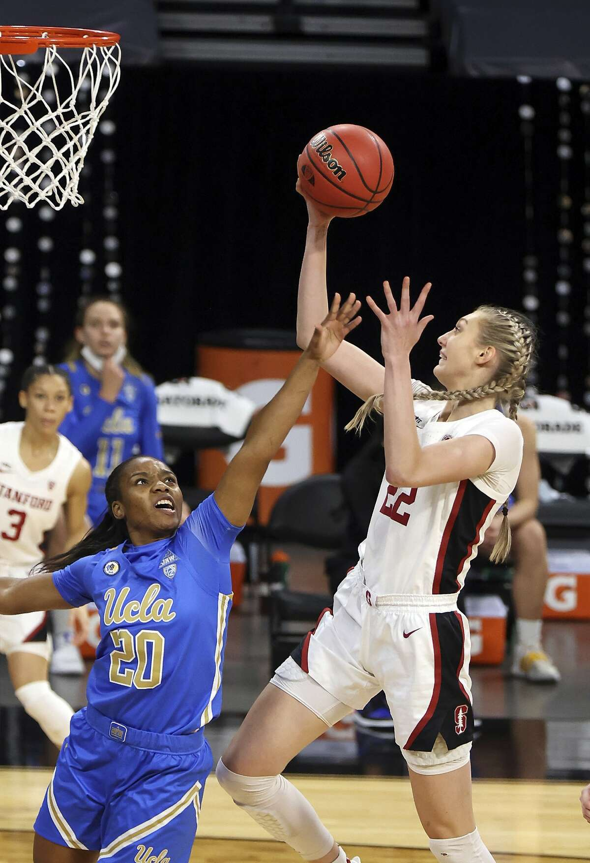 Stanford forward Cameron Brink (22) shoots as UCLA guard Charisma Osborne (20) defends during the first half of an NCAA college basketball game in the Pac-12 women's tournament championship Sunday, March 7, 2021, in Las Vegas. (AP Photo/Isaac Brekken)