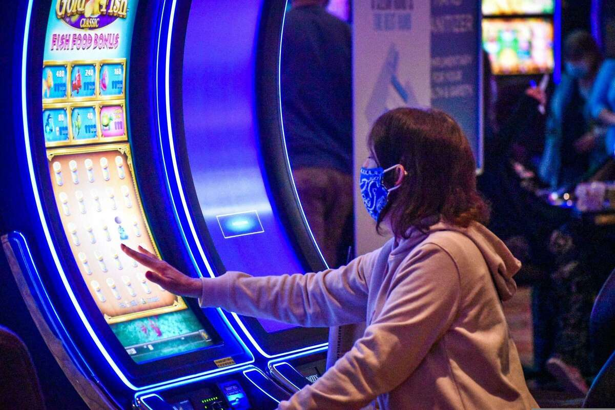 A gambler uses a video gaming machine at Foxwoods Resort Casino in Connecticut.
