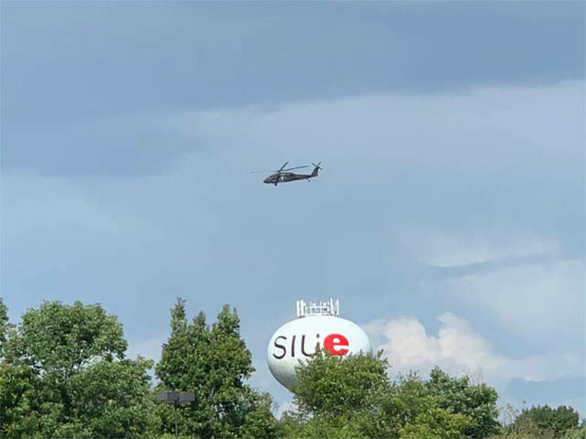 A UH-60 Black Hawk flies over the Southern Illinois University Edwardsville campus.