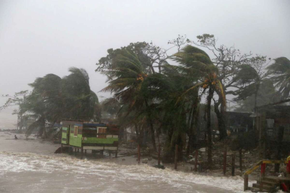 Palm trees blow by wind as Nicaragua prepares to receive Hurricane Iota on November 16, 2020 in Puerto Cabezas, Nicaragua. Starting in 2021, Atlantic hurricanes will no longer be named using the Greek alphabet. (Photo by Maynor Valenzuela/Getty Images)