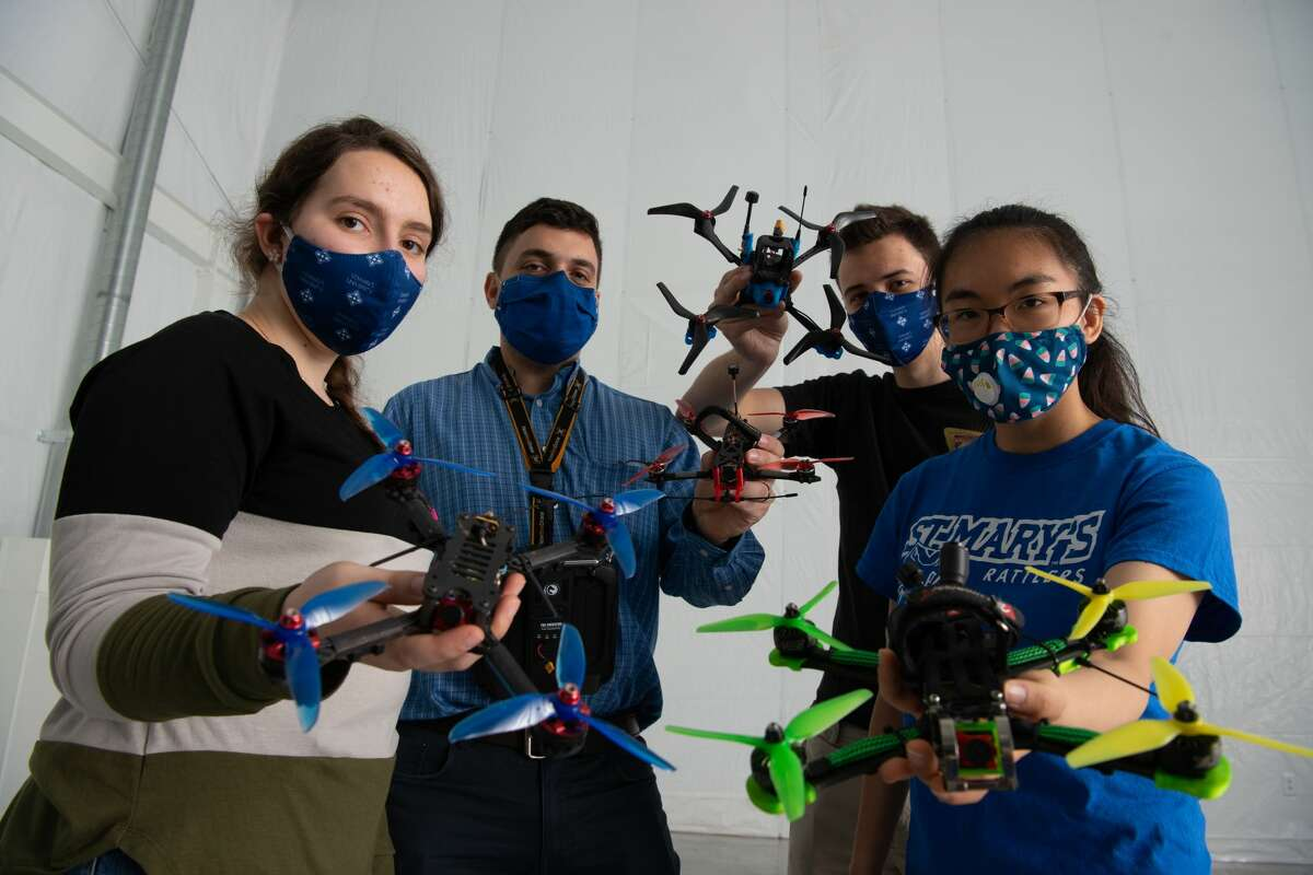 L-R: Nicole Webb, St. Mary's University Engineering Technician in the Drone Lab; Dante Tezza, Assistant Professor of Computer/Software Engineering; Baptiste Pousset, Electrical Engineering senior; and Kimberly Tse, Computer Engineering senior, showcase the variety of drones available for students to use in the new St. Mary's University Drone Lab.