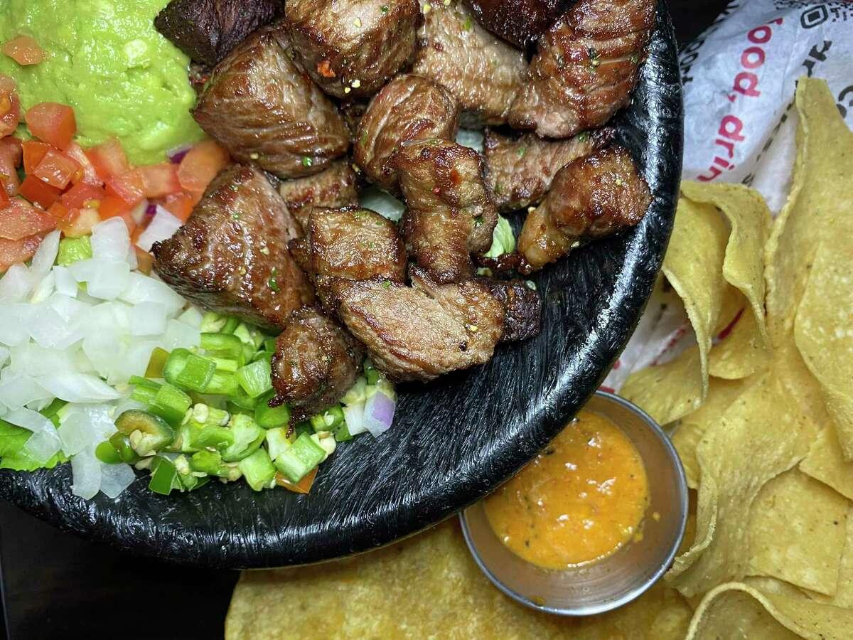 Chicharrón de rib-eye is fried steak served with guacamole, pico de gallo and tortillas at Cervecería 88.