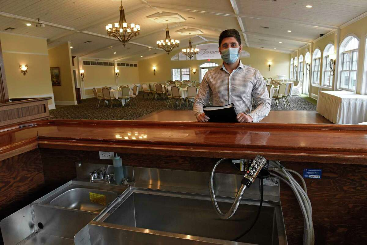 General Manager Joe Popolizio stands at the bar in The Terrace at Water's Edge, the banquet area where weddings are held at Waters Edge Ligthouse on Thursday, March 18, 2021 in Glenville, N.Y. (Lori Van Buren/Times Union)