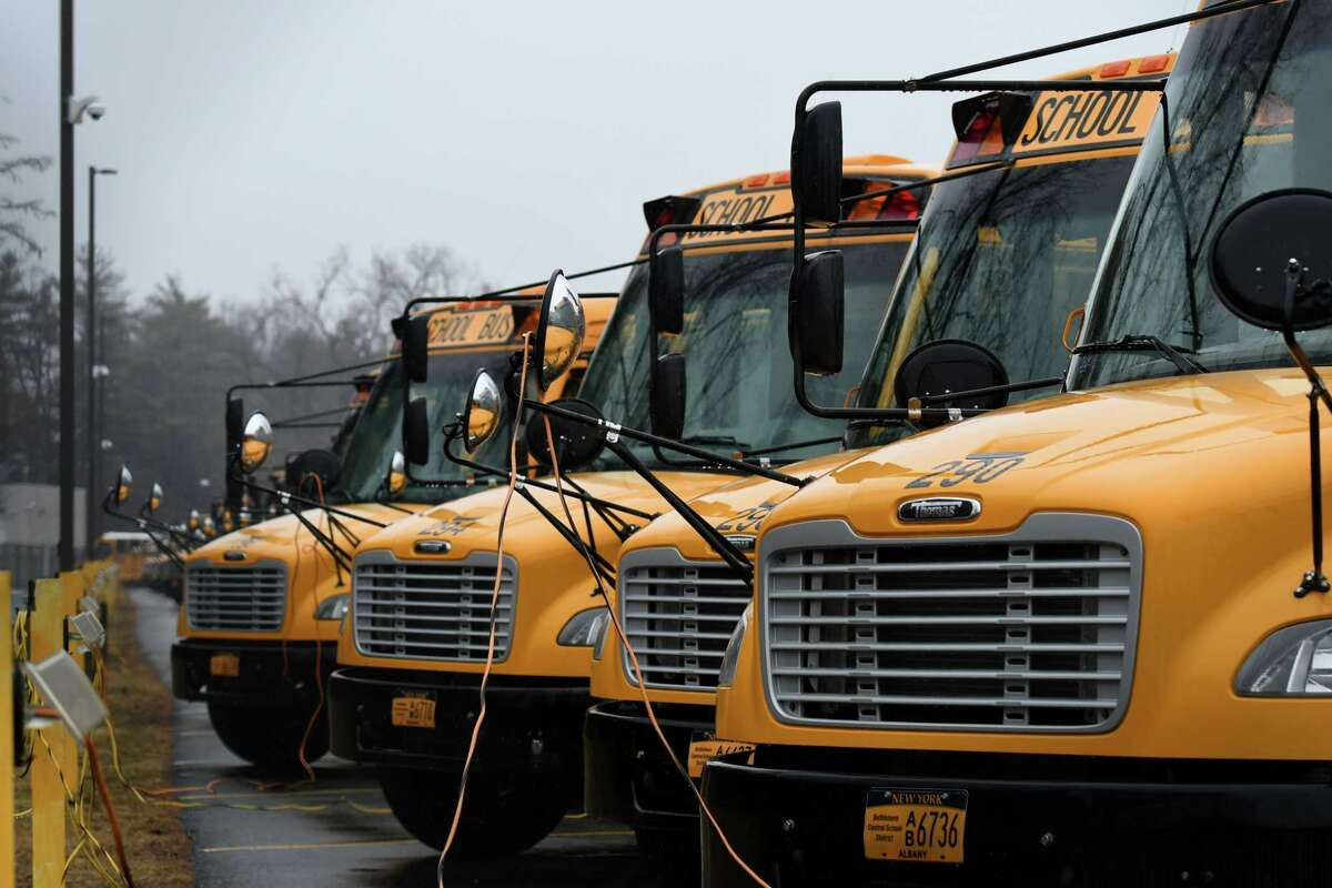 Buses are parked at the Bethlehem Central School District School Bus Garage on Wednesday, March 17, 2021, in Bethlehem, N.Y. A former student is suing the school district over an alleged claim of child sexual abuse by a bus driver that took place in the 1980s. (Will Waldron/Times Union)