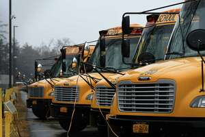 Busses are parked at the Bethlehem Central School District School Bus Garage on Wednesday, March 17, 2021, in Bethlehem, N.Y. District residents will vote in May on whether Bethlehem schools will be among the first in New York to use electric school buses. The district wants to purchase up to nine electric school buses, which would be partially paid for with a grant from the New York State Energy Research  and Development Authority. (Will Waldron/Times Union)